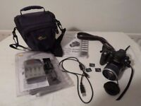 Fuji Finepix Digital Camera with instruction manual, bag, download cable, batteries and charger