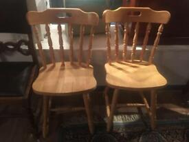 2 wooden chairs and table