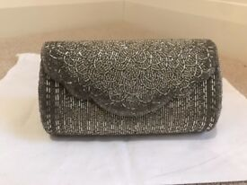 Silver beaded Dune clutch bag