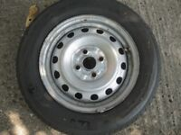 A good Wheel with Tyre 185/65 R14 .. for a Vauxhall Astra .. I think