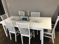 Extendable IKEA dining table and 6 chairs for sale