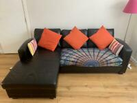 Brown leather sofa bed with storage