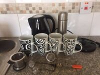 Kettle, 2 Mugs, 2 Egg Tea Strainers, 1 Cup Strainer, 1 Tong Tea Strainer, 1 Thermus.