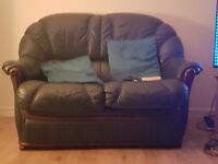 2 seater and 3 seater green leather look sofas