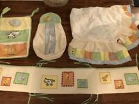 Beautiful like new set of cot skirt, bumper, nappy holder and accessories pockets