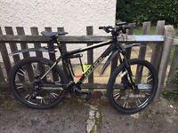 Stolen mountain bike - London Rd. Carrera Vulcan black/grey Monday 2 Jan. 5:50 p.m.