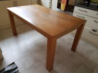 Wooden dining table for sale, can sit up to 6 people, priced low for a quick sale