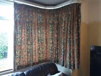 Green based flowered curtains