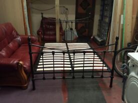 black metal ornamental double bed frame with center support
