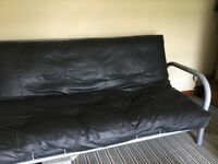 Double sofa bed in black leather. Rarely used . In excellent condition.