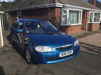 For sale mazda 323 LXI 5 door in very good condition comes with full service history only 62,268 mls