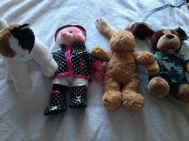 4 Build A Bears including clothes, shoes, roller skates and accessories