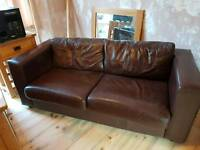 Large chocolate brown leather sofa bed