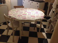 Round kitchen table, three chairs + tablecloth