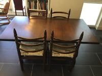 Toledo extending dining table and six chairs by Younger