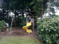 Play house with slide, swings and rope swing