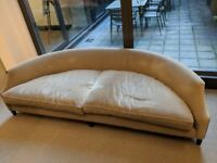 Large crescent sofa with suede upholstery