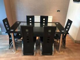 Glass dinning table and six chairs