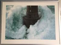 Large framed IKEA picture of lighthouse in storm