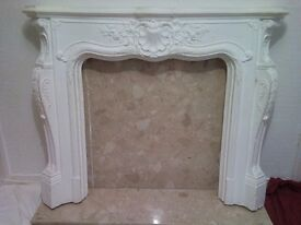 Fire surround with solid marble hearth and backplate