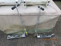 Two silver micro scooters for sale
