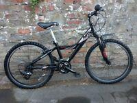 "Black Giant MTX 225 Mountain Bike. 24"" Wheels. Front suspension. New Shimano Revoshift Gear shifters"