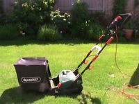 Qualcast Electric cylinder lawnmower with grass box (still under guarantee).