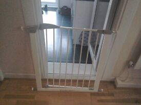 A safababy gate for stairs or doors ,a white Lindam in very good conditions