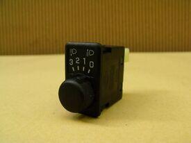 Nissan Almera, Primera headlight level adjustment switch.