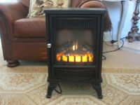 """Electric """"WOODBURNER"""" convection heater."""