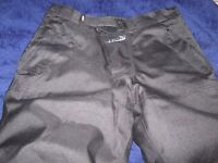 Tuzo Storm Waterproof Bike trousers in Black size 34S worn once