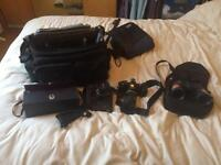 Old Nikon cameras and binoculars all with bags