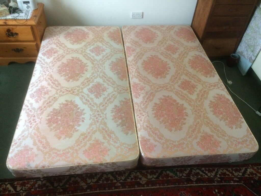 Two matching single beds (6ft 3ins by 3ft).