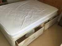 Double duvan bed with 4 drawers and wooden headboard
