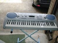 Yamaha PSR 275 Keyboard and stand with instruction ex con.