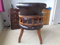 Captain's chair in antique brown leather, lovely condition solid and graceful