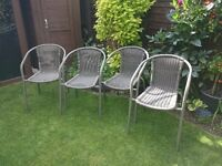 Four Brand New Garden Chairs