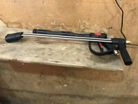 Pressure washer gun with double lance