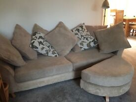 4 seater sofa and 2 foot rests