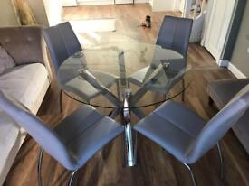 Next round glass dining table and four chairs