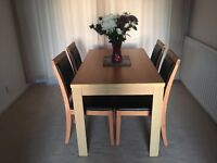 Dining table and 4 chairs - Texas oak table and black cushion chairs