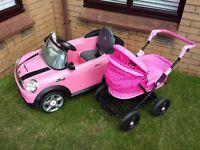 Pink mini electric car and pram