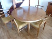 REDUCED. McIntosh extending round teak table with 4 chairs 1970,s style.