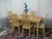 Like new dinning table and 6 chairs