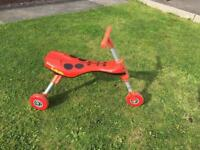 Scuttlebug - red folding trike for toddlers