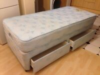 Single Bed with drawers and headboard.