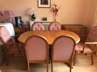 Sutcliffe extendable dining room table and 6 chairs.