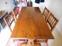 Oak table with 4 chairs. Table L 152 cm. W 68.5 cm. Ht 71.5 cm.