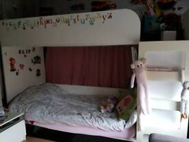 Double bunk bed with drawer storage and inbuilt wardrobe