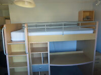 Children's high sleeper cabin bed with desk, steps and storage space